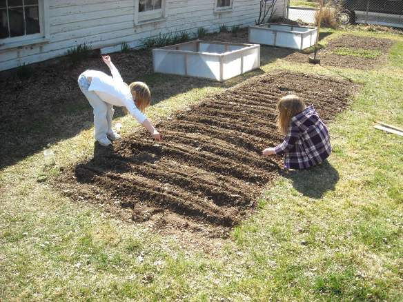 Two girls planting
