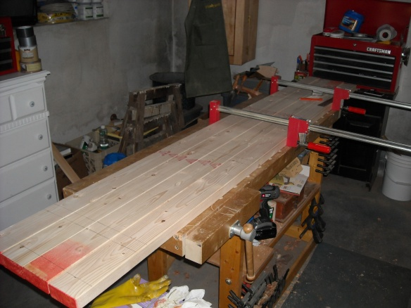 Laying out the boards for the pea fences.